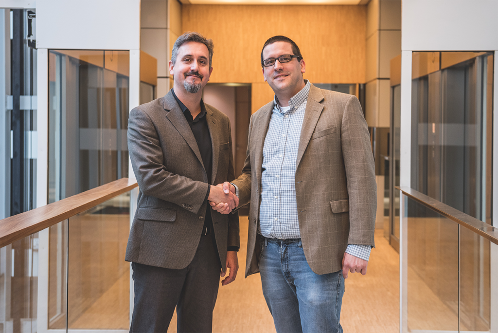 Phillip Miller, International Vicepresident of Open Source Services for Blackboard Inc., and Martin Dougiamas, Founder and CEO of Moodle Pty Ltd.