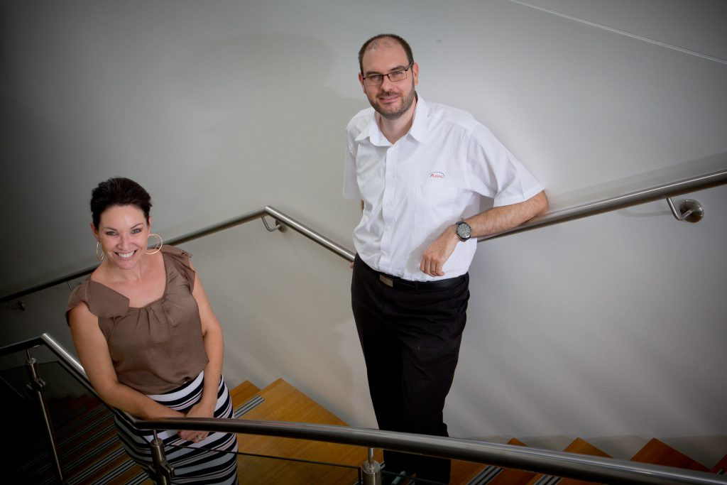 Michael Smart, Axial Head of Administration (L) and Alena Smith, Axial General Manager (R) at Axial Head Office in Underwood. Photo: AFP Patrick Hamilton.
