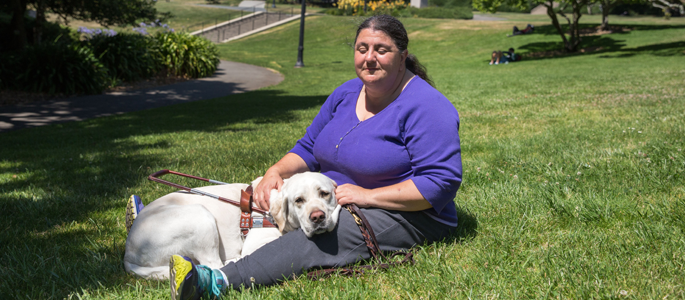 Lucy Greco, Web Accessibility Evangelist at the University of California, Berkeley, and Frances, her friendly partner dog, Berkeley, CA, USA. Photo: AFP Jana Asenbrennerova.