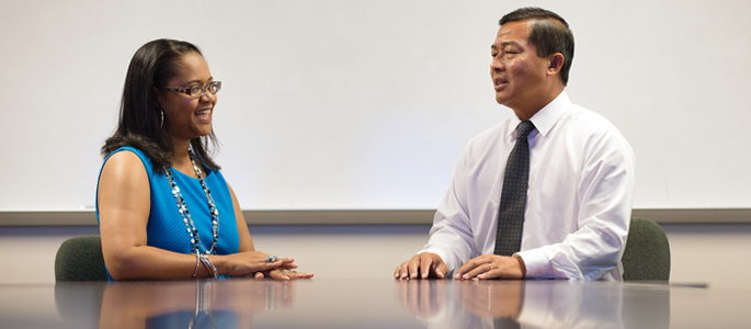 Dr. Torria Davis, instructional designer for OPS (left) and Dr. Tranh Hong, Associate Vice President of Technology (right) at California Baptiste University. Riverside, CA, USA. Photo: AFP Kyle Grillot.
